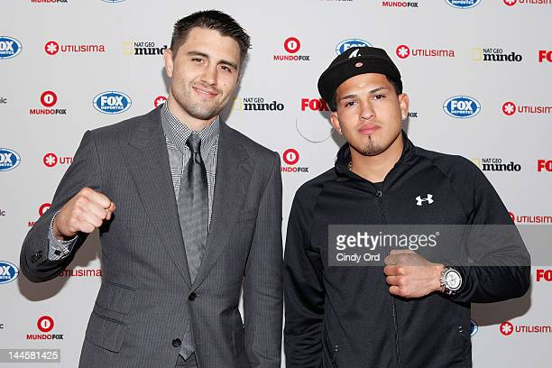 UFC fighters Carlos Condit and Anthony Pettis attend the Fox Hispanic Media Upfront at Ziegfeld Theatre on May 16 2012 in New York City
