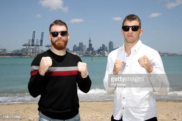 Fighters Dan Hooker and Paul Felder face off on the beach at Devonport during a UFC Auckland media opportunity at Spark Arena on December 04, 2019 in...