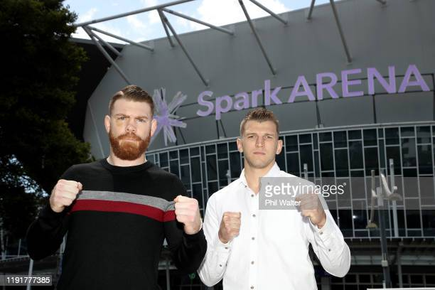 Fighters Dan Hooker and Paul Felder face off outside Spark Arena during a UFC Auckland media opportunity at Spark Arena on December 04, 2019 in...