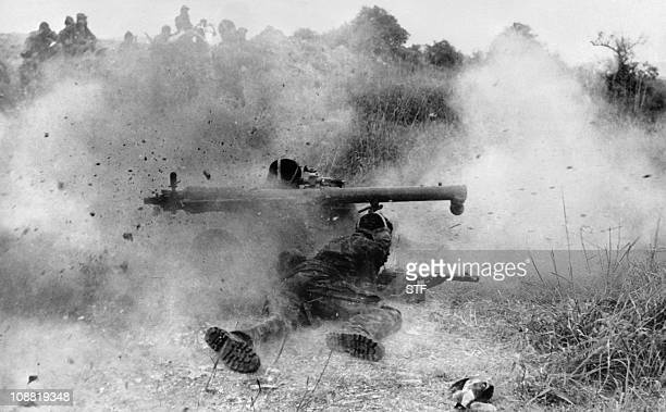 fighters fire with a bazooka and a machine gun during fightings on January 27 1976 near Huambo Angola After independence Angola was the scene of an...