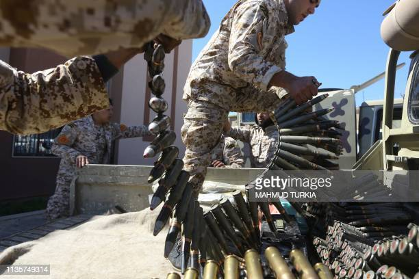 Fighters from a Misrata armed group loyal to the internationally recognised Libyan Government of National Accord prepare their ammunition before...
