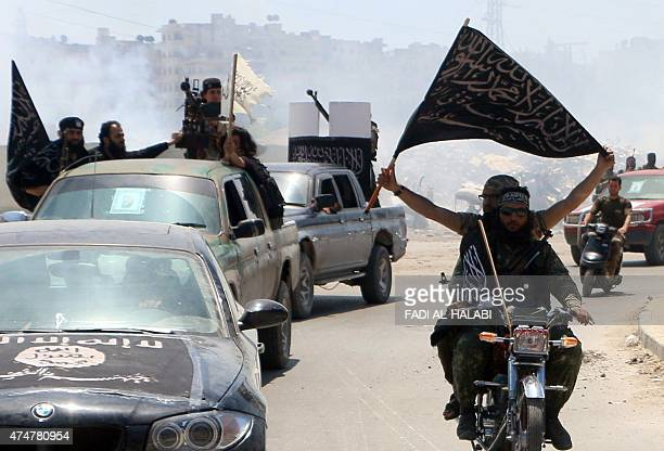 Fighters from AlQaeda's Syrian affiliate AlNusra Front drive in the northern Syrian city of Aleppo flying Islamist flags as they head to a frontline...