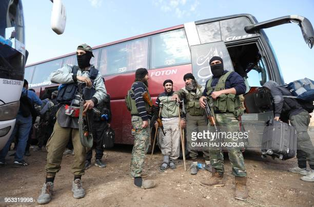 TOPSHOT Fighters from Hayat Tahrir alSham and members of their families arrive in a rebelheld area of the AlEis crossing in Syria's northern Aleppo...