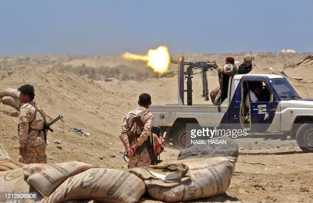 Fighters from of the Southern Transitional Council fire towards the positions of Saudi-backed government forces during clashes in the Sheikh Salim...