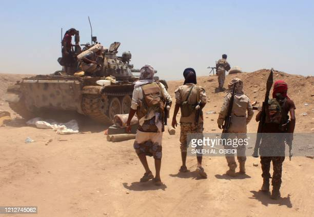 Fighters from of the Southern Transitional Council fire towards the positions of Saudibacked government forces during clashes in the Sheikh Salim...
