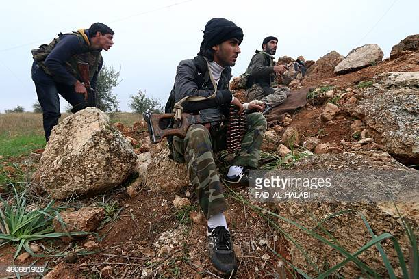 Fighters from the AlNusra Front AlQaeda's Syria branch hold a position as they fight against forces loyal to the regime on December 19 2014 in the...