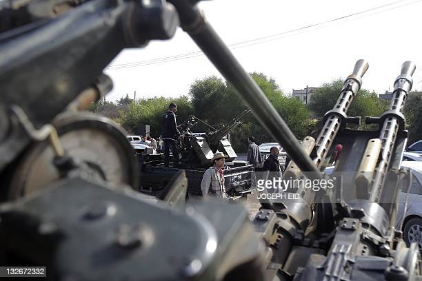 Fighters from the city of Misrata man a checkpoint on the road between Wershefana and Zawiyah cities at checkpoint 27 west of Tripoli on November 13...