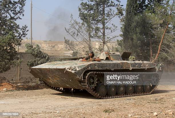Fighters from the former AlNusra Front renamed Fateh alSham Front after breaking from AlQaeda drive a tank as they seized key positions south of...