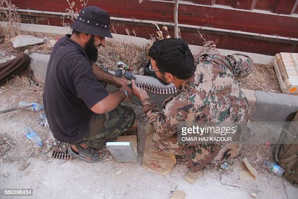 Fighters from the former AlNusra Front renamed Fateh alSham Front after breaking from AlQaeda prepare their weapons at an armament school after they...