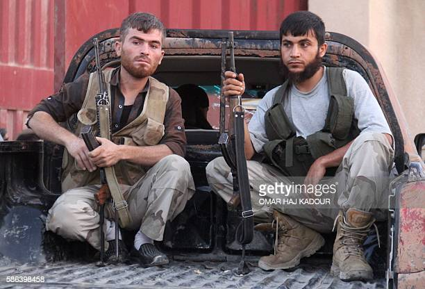 Fighters from the former AlNusra Front renamed Fateh alSham Front after breaking from AlQaeda pose for a photo after they recaptured an armament...