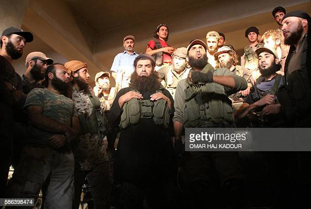 Fighters from the former AlNusra Front renamed Fateh alSham Front after breaking from AlQaeda listen to a speech at an armament school after they...