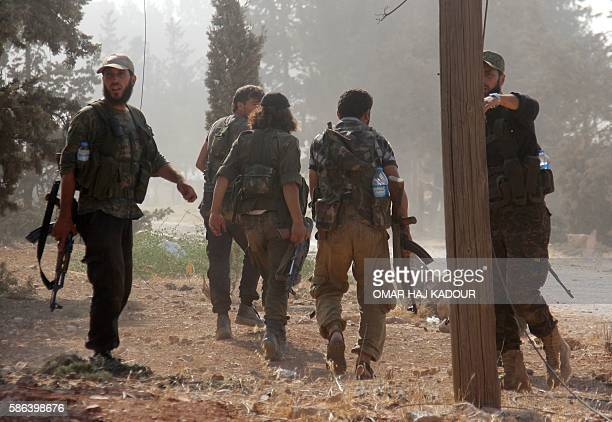 Fighters from the former AlNusra Front renamed Fateh alSham Front after breaking from AlQaeda advance at an armament school after they announced they...