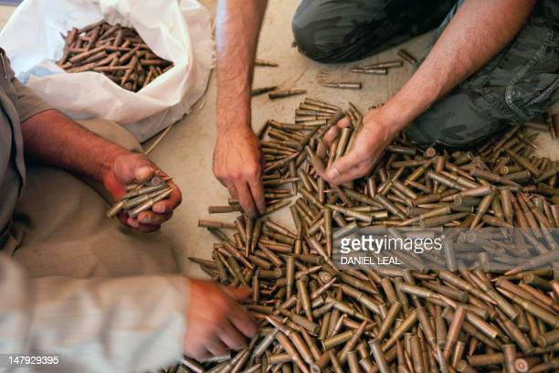 Fighters from the Free Syrian Army buy AK47 bullets from a weapons seller in Idlib province on July 4 2012 US Secretary of State Hillary Clinton...