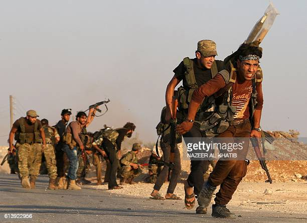 Fighters from the Free Syrian Army take part in a battle against the Islamic State group jihadists in the northern Syrian village of Yahmoul in the...