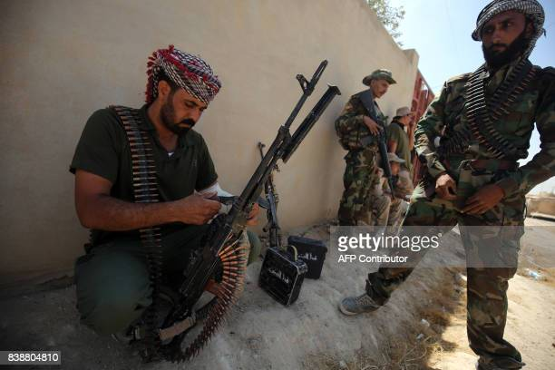 TOPSHOT Fighters from the Hashed AlShaabi advance inside alNour neighbourhood in eastern Tal Afar the main remaining stronghold of the Islamic State...