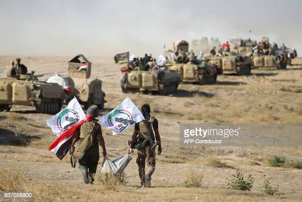 TOPSHOT Fighters from the Hashed AlShaabi advance towards the town of Tal Afar west of Mosul after the Iraqi government announced the beginning of...