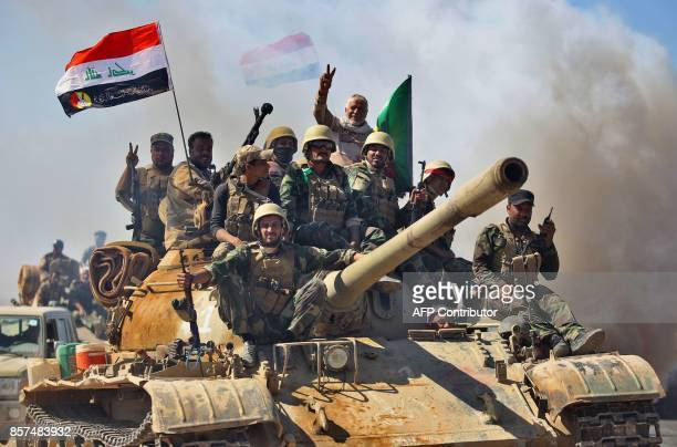 Fighters from the Hashed alShaabi backing Iraqi forces advance towards the Islamic State group's stronghold of Hawija on October 4 during an...