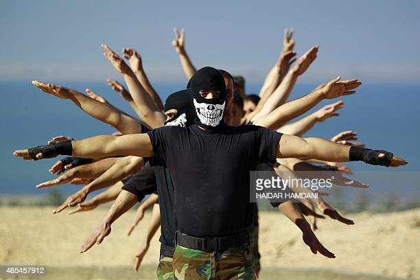 Fighters from the Iraqi Imam Ali Brigade, take part in a training exercise in Iraq's central city of Najaf on March 7 ahead of joining the military...