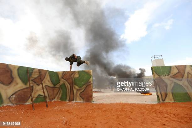 TOPSHOT Fighters from the Jaysh alIzza affiliated with the Turkishbacked Free Syrian Army take part in a training session in the northwestern Syrian...