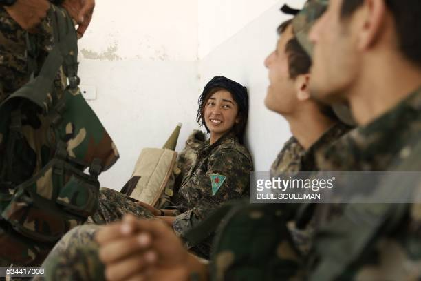 Fighters from the Kurdish People's Protection Units part of the Syrian Democratic Forces are seen in the village of Fatisah in the northern Syrian...