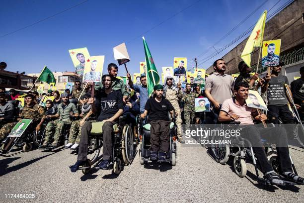 Fighters from the Kurdish women's protection units and the people's protection units march in front of the UN headquarters in the northern Kurdish...