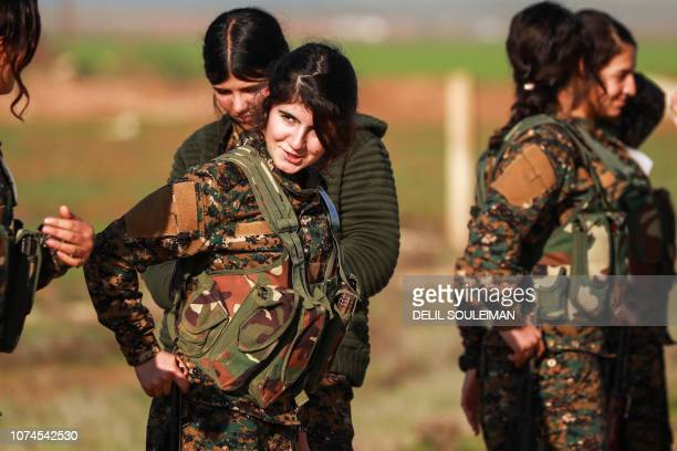 Fighters from the Kurdish women's protection units attend the funeral of an Arab fighter of the Syrian Democratic Forces in the town of Tal Tamr in...