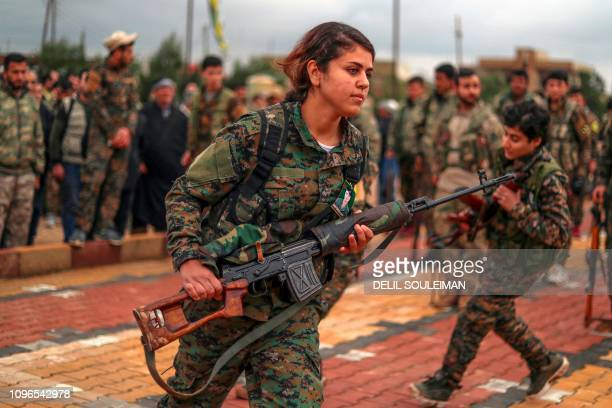 Fighters from the Kurdish women's protection units attend the funeral of a fellow fighter who was killed while fighting against the Islamic State in...