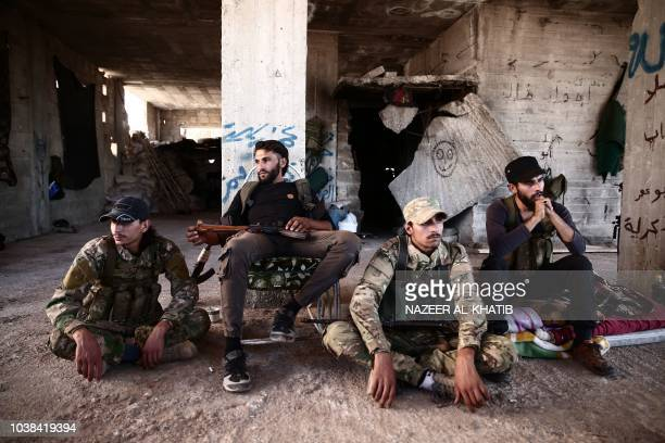 TOPSHOT Fighters from the Nureddine alZinki unit a moderate Syrian opposition faction affiliated with the Muslim Brotherhood and made up of former...