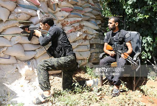 Fighters from the Nureddine alZinki unit a moderate Syrian opposition faction affiliated with the Muslim Brotherhood and made up of former Syrian...