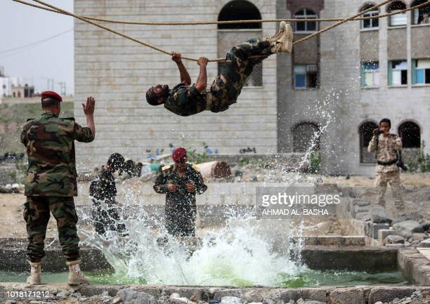 Fighters from the Popular Resistance Committees supporting forces loyal to Yemen's Saudibacked President Abedrabbo Mansour Hadi perform manoeuvres...