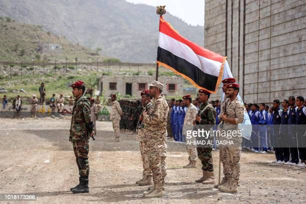 Fighters from the Popular Resistance Committees supporting forces loyal to Yemen's Saudibacked President Abedrabbo Mansour Hadi lineup during a...