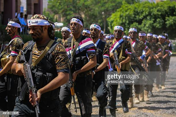 Fighters from the Popular Resistance Committees, supporting forces loyal to Yemen's Saudi-backed President Abedrabbo Mansour Hadi, march during a...