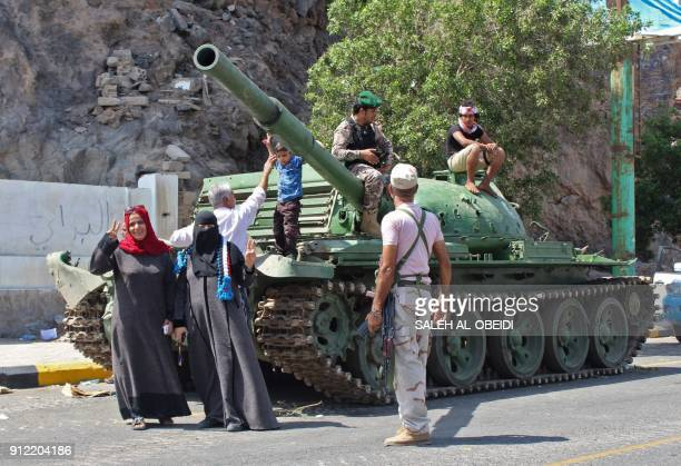 Fighters from the separatist Southern Transitional Council and their supporters parade around the area of the presidential palace in the government's...