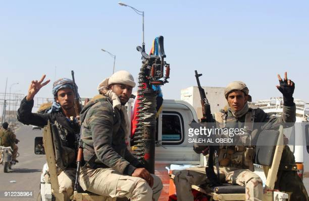 Fighters from the separatist Southern Transitional Council drive on the back of armoured vehicles in Aden's northern Dar Saad district as they move...