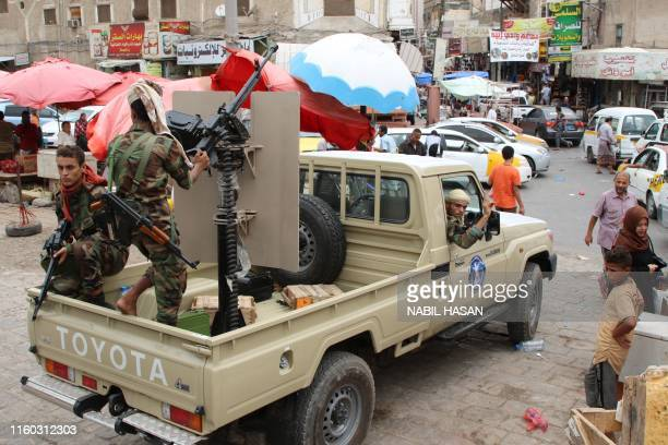 Fighters from the separatist Southern Transitional Council drive their pick up in Aden on August 08, 2019. - Yemen's Southern Transitional Council,...