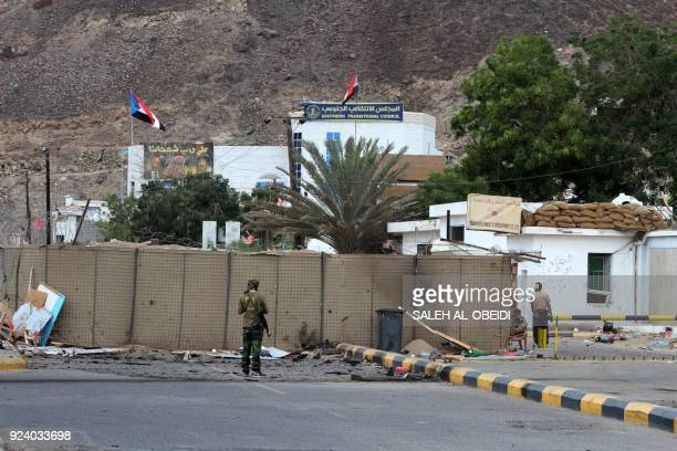Fighters from the separatist Southern Transitional Council gather on February 25 at the site of two suicide car bombings that targeted the...