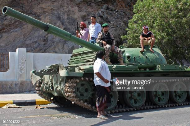 Fighters from the separatist Southern Transitional Council parade around the area of the presidential palace in the government's de facto capital...