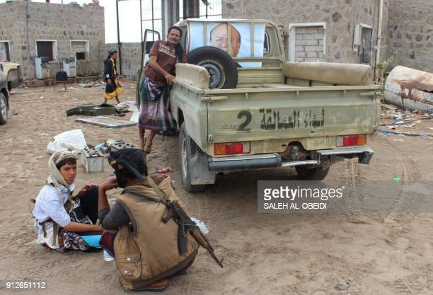 Fighters from the separatist Southern Transitional Council rest at a military camp after they took control of the progovernment position in the...