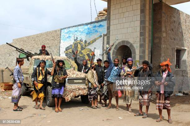Fighters from the separatist Southern Transitional Council stand at the entrance of a military camp after they took control of the progovernment...