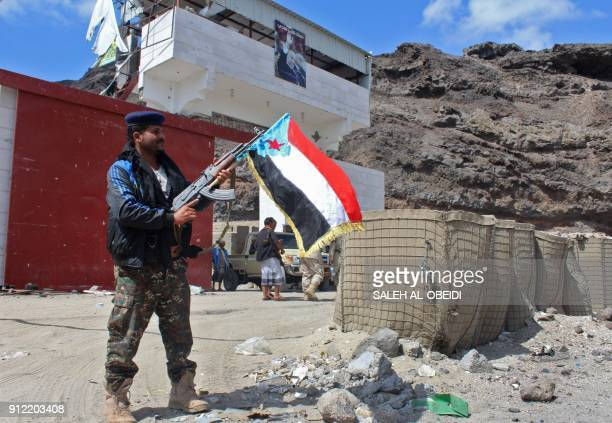 Fighters from the separatist Southern Transitional Council take control of a progovernment checkpoint in Khormaksar north of Aden on January 30 2018...