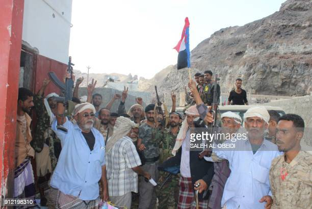 Fighters from the separatist Southern Transitional Council wave the movement's flag after they took control of a progovernment checkpoint in...