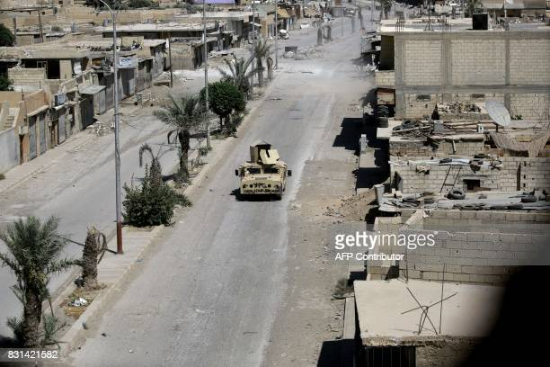 Fighters from the Syrian Democratic Forces a US backed KurdishArab alliance advance in Raqa's western alDarya neighbourhood on August 14 as Syrian...