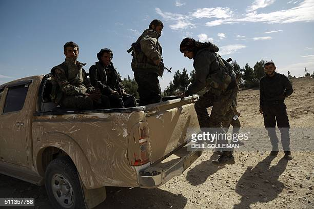 Fighters from the Syrian Democratic Forces are transported to the front line of the town of alShadadi in the northeastern Syrian province of Hasakeh...