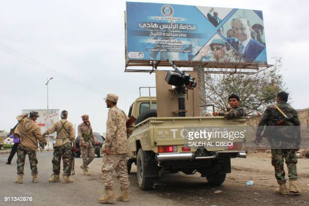 Fighters from Yemen's southern separatist movement gather in a street of the country's second city of Aden on January 28 during clashes with forces...
