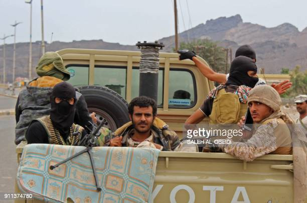 Fighters from Yemen's southern separatist movement sit in the back of a pickup truck in the country's second city of Aden on January 28 during...