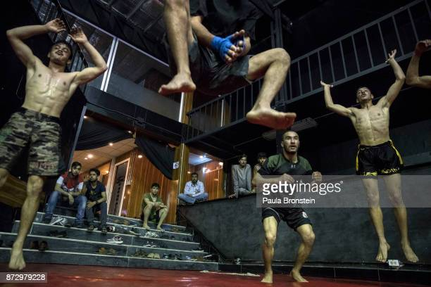 Fighters leap into the air during training at the Snow Leopard Fighting Championship gym ON MAY 72017 in Kabul Sports like Cricket and soccer are...