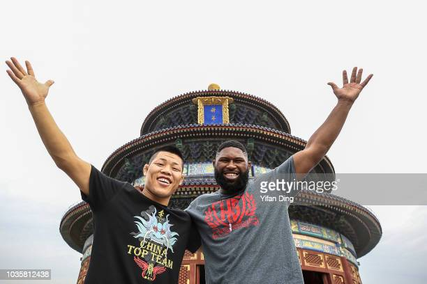 UFC fighters Li Jingliang of China and Curtis Blaydes of the United States pose for photo during UFC Fight Night Beijing Athlete Tour at Temple of...