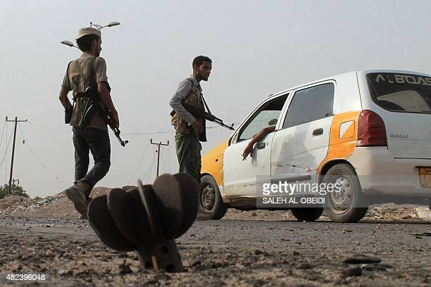 Fighters loyal to exiled President Abedrabbo Mansour Hadi man a checkpoint in the Dar Saad suburb in the north of the southern embattled Yemeni city...