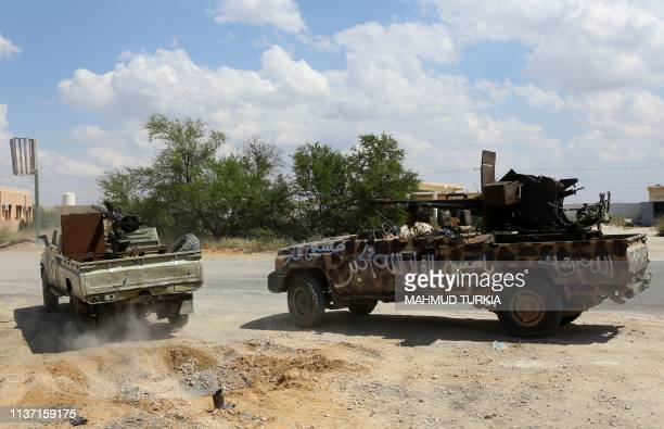 Fighters loyal to Libya's Government of National Accord hold a position west of the city of Aziziah some 60 kilometres southwest of the capital...