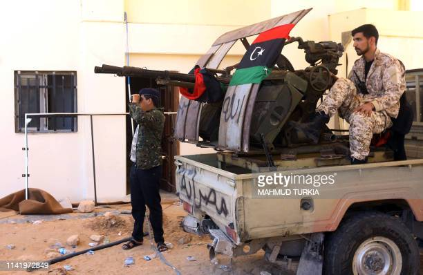 Fighters loyal to the internationally recognised Libyan Government of National Accord keep position near the Salah al-Din military compound, south of...